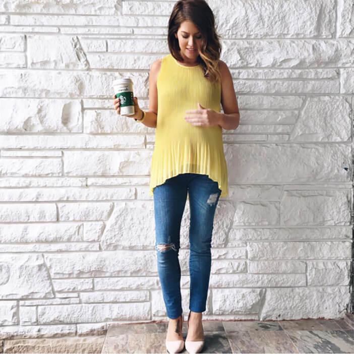 Jillian Harris wearing yellow zara shirt and yomama maternity jeans
