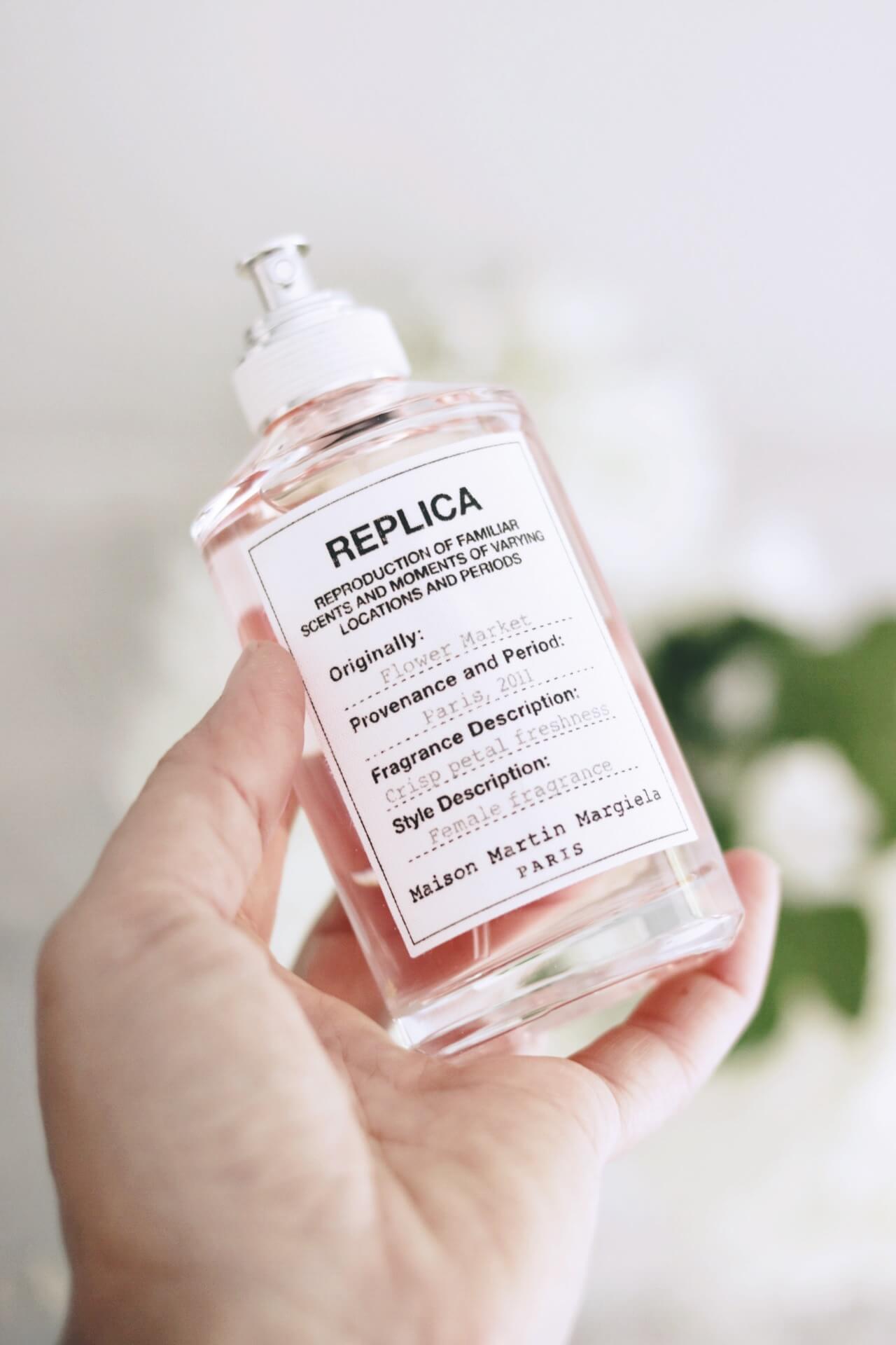 Jillian Harris Holding Replica Perfume by Maison Martin Margiella