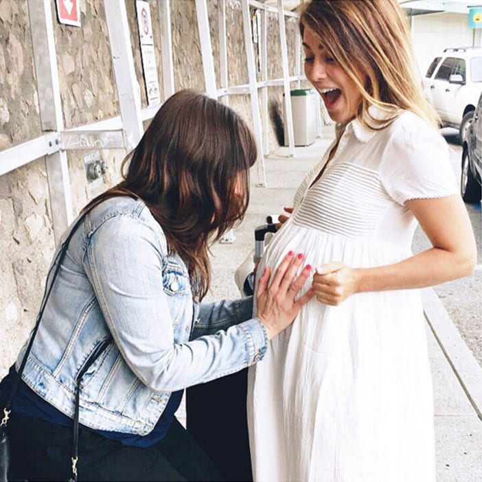 Karissa kissing baby bump in Aritzia dress
