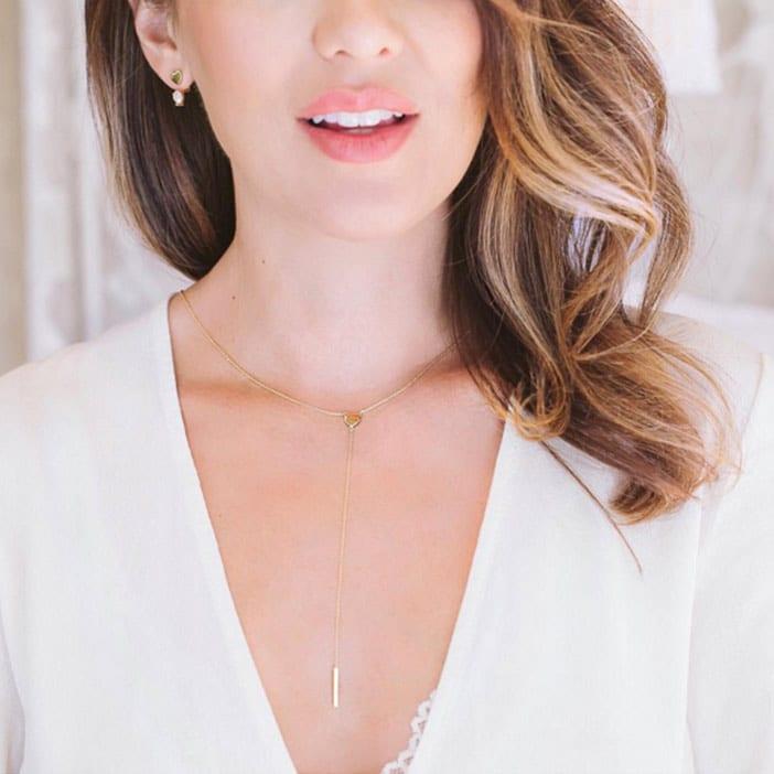 Jillian-Harris-wearing-JHxMA-heart-lariat-necklace