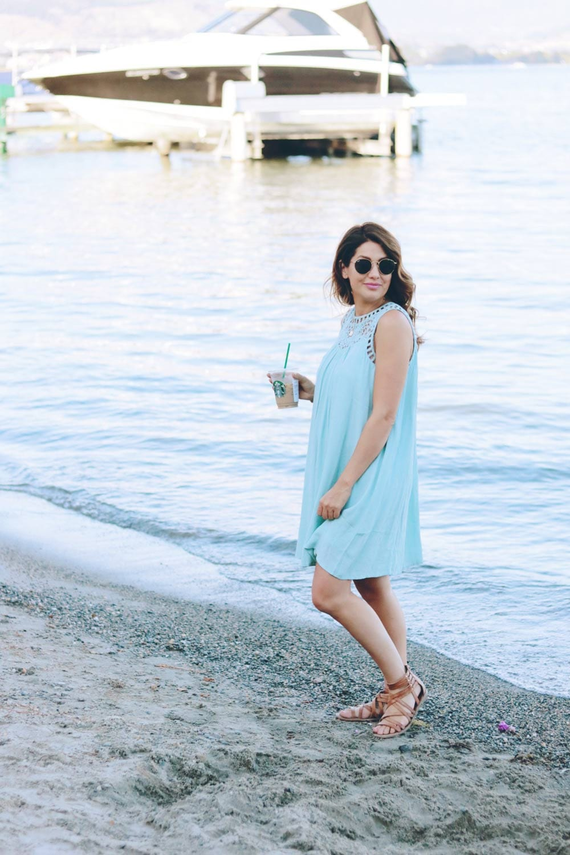 jill-standing-with-starbucks-on-beach