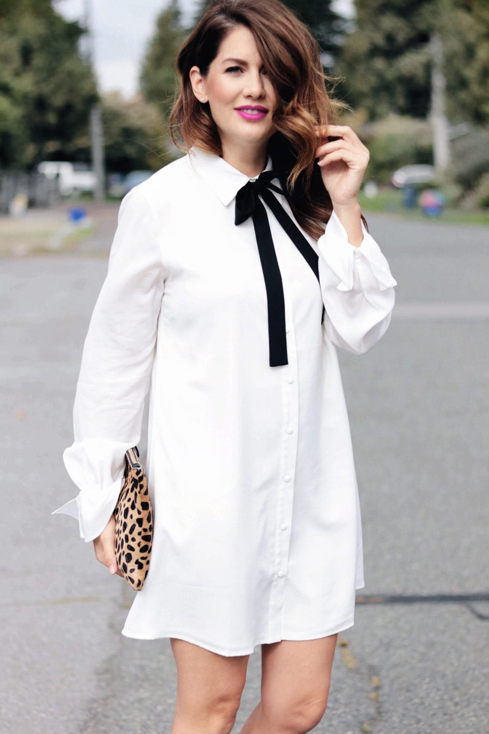 jillian harris wearing button up dress with bow tie