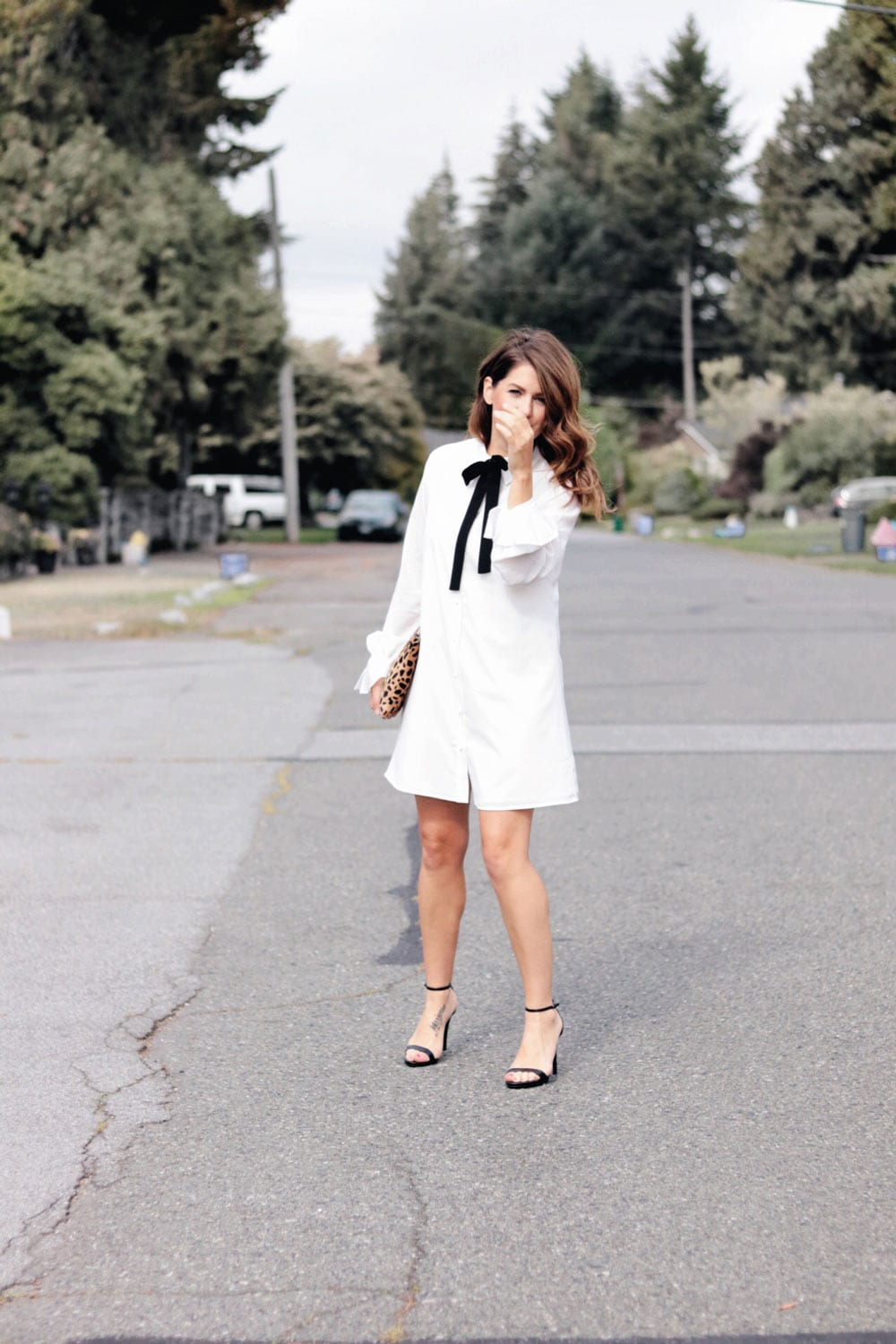 Jillian on set of Love It Or List it wearing white button up Nordstrom dress