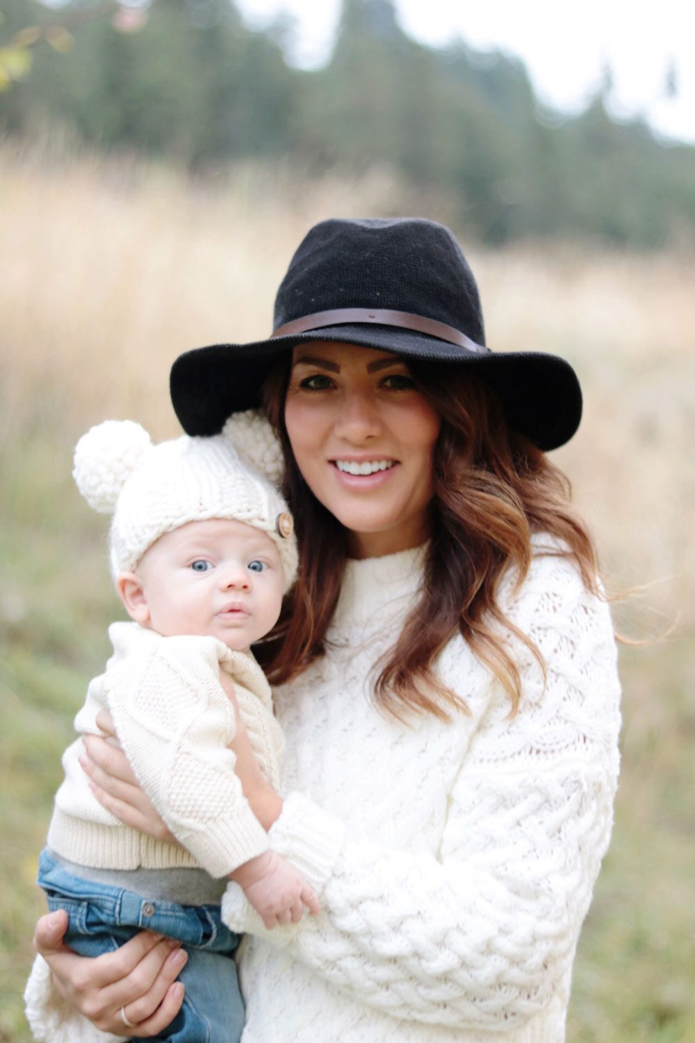 jill-holding-leo-in-the-orchard-in-goodnight-macaroon-sweater-and-hat