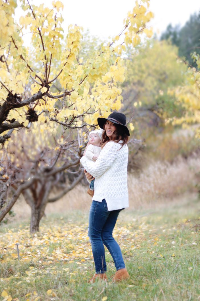 jill-holding-leo-in-the-orchard