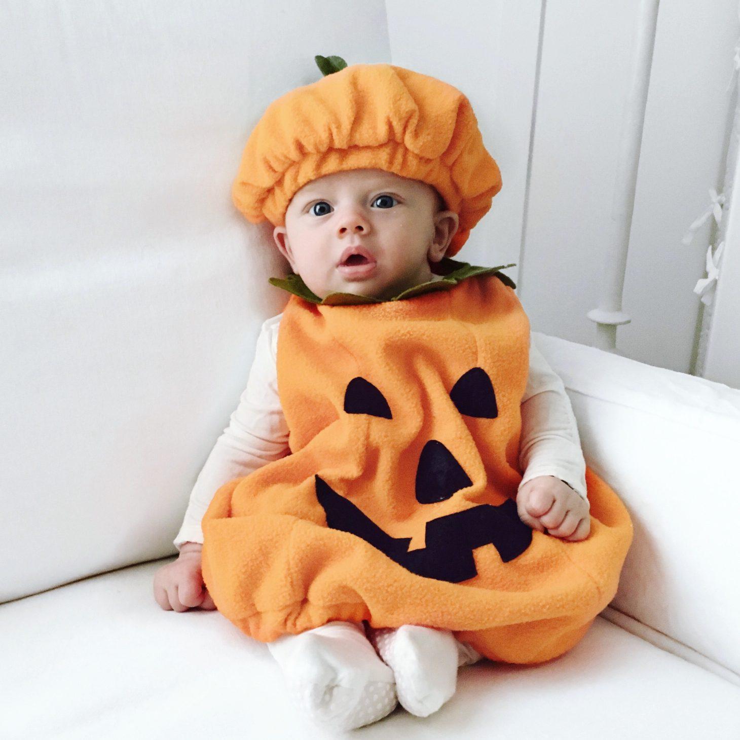 Leo in first pumpkin halloween costume