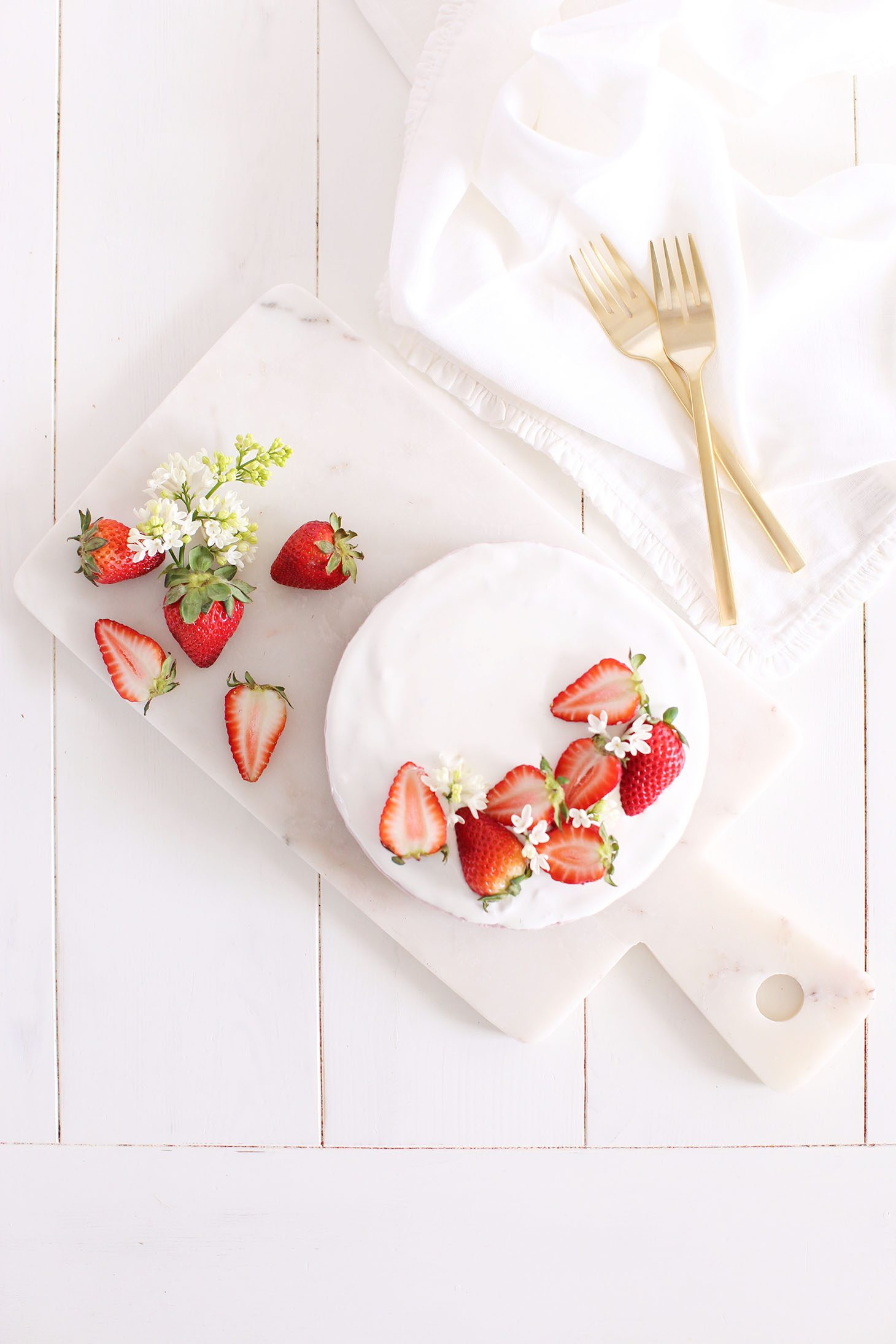 Berry Cheesecake garnished with strawberries.