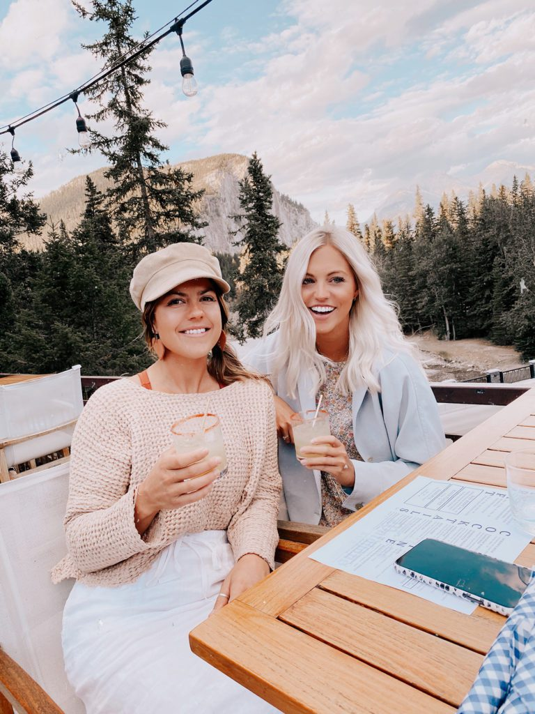 Shay with her friend having dinner in Banff