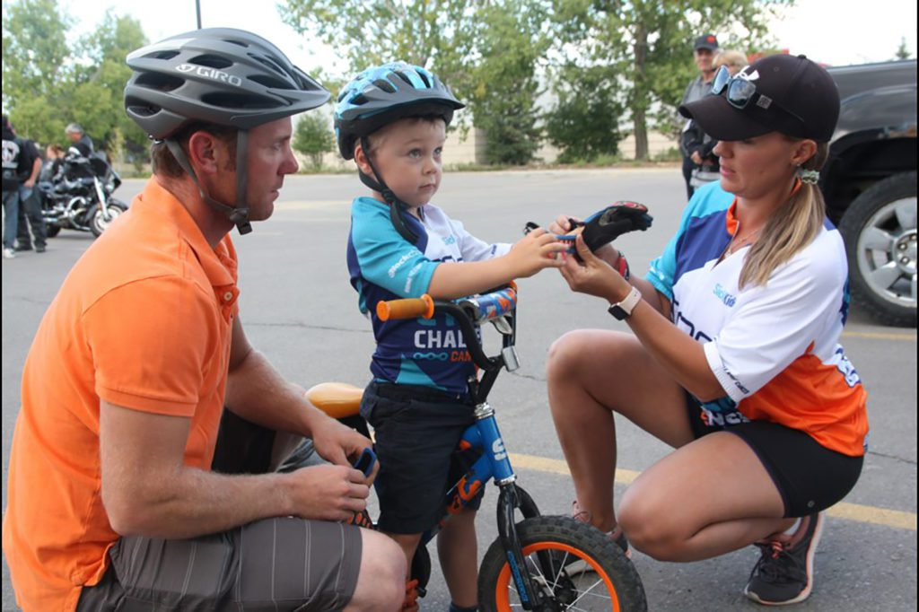 3-year-old Kolton Davis getting ready to ride to help conquer childhood cancer