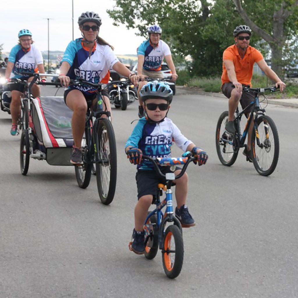 Kolton riding with his family