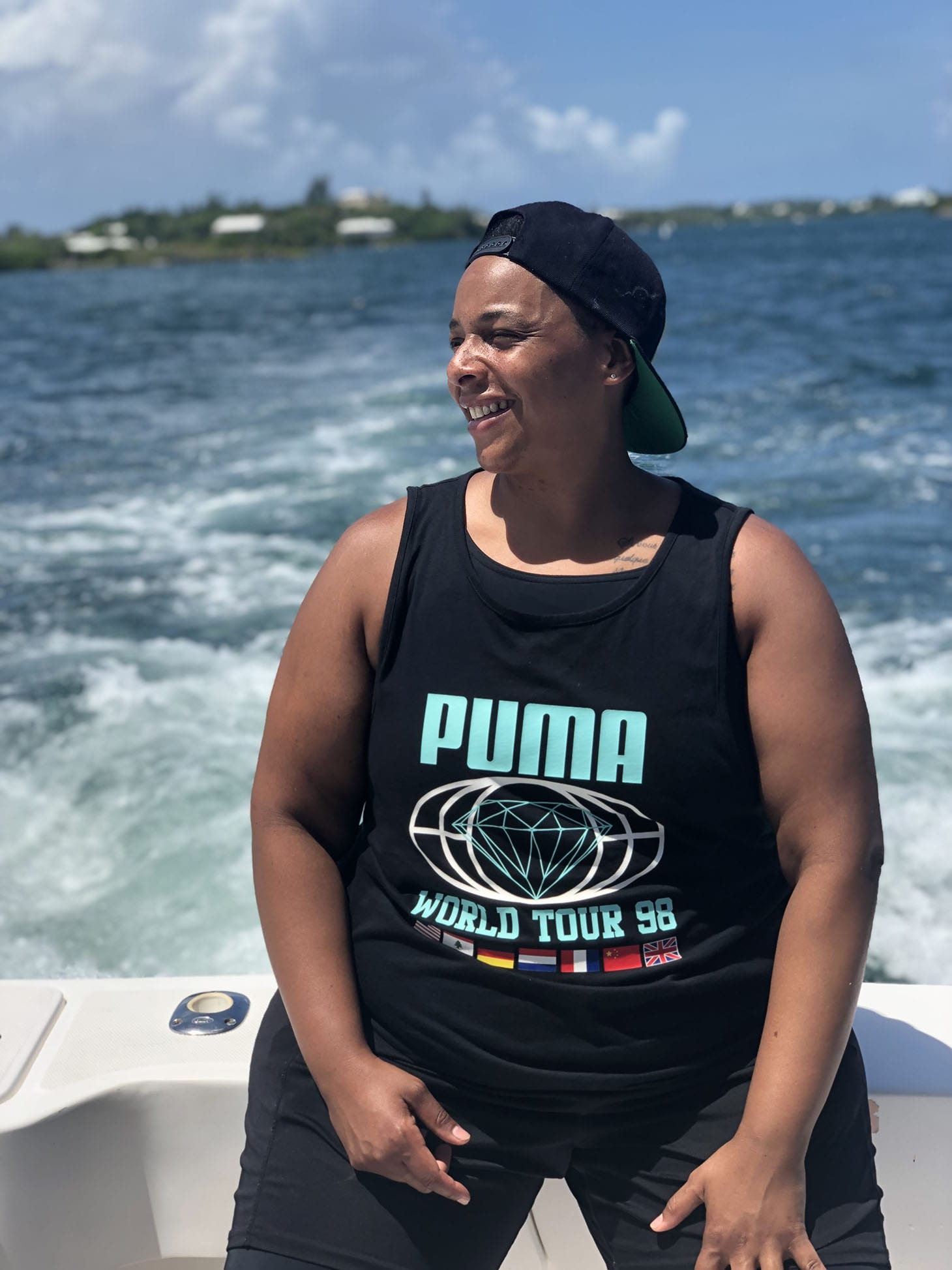 Health and Wellness coach, Coach Carey on a boat on a sunny day.