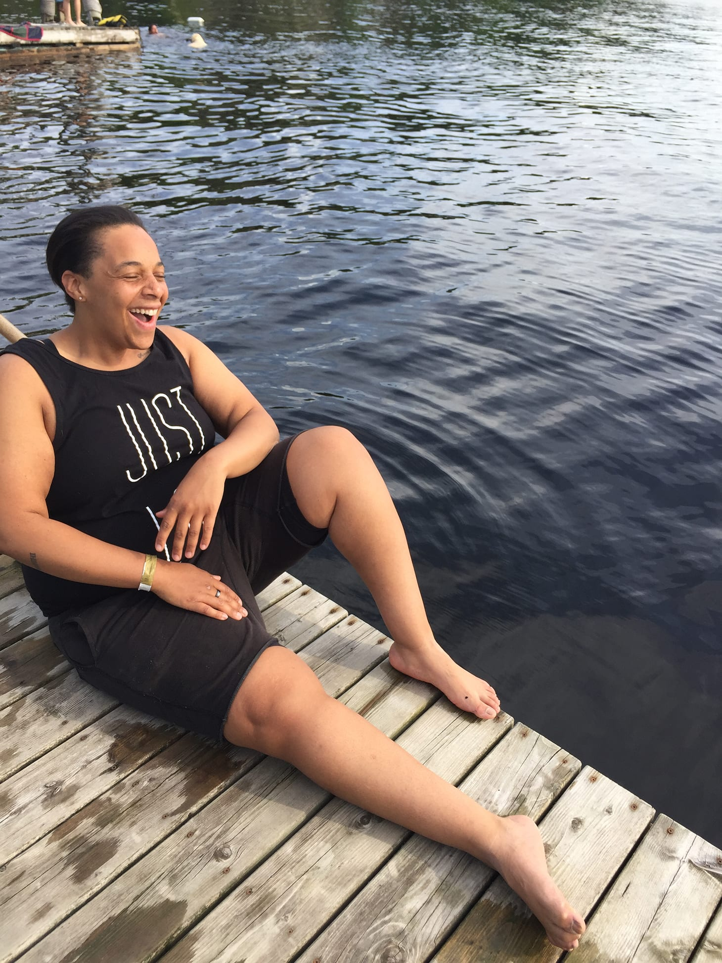 Health and wellness coach, Coach Carey on a dock.