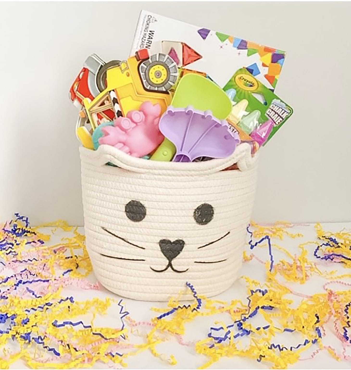 Presents for Kids in a basket with a bunny face on it.