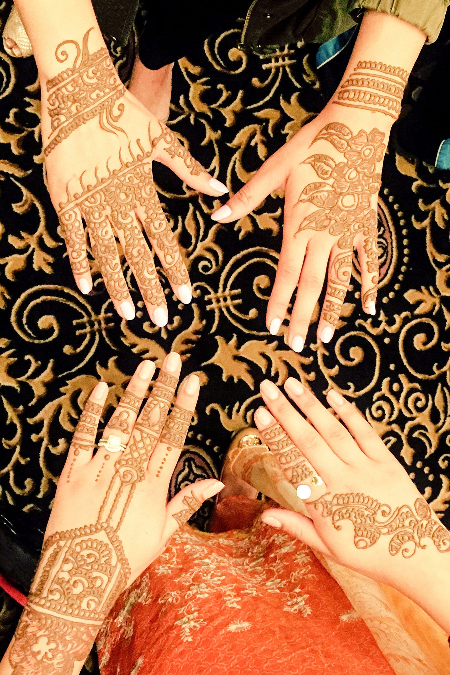 Henna Tattoo on a 2 womens hands.