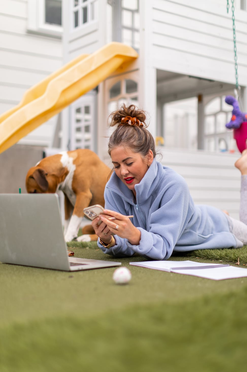 Jillian Harris working on The Jilly Academy at home at her children's playground over the summer.