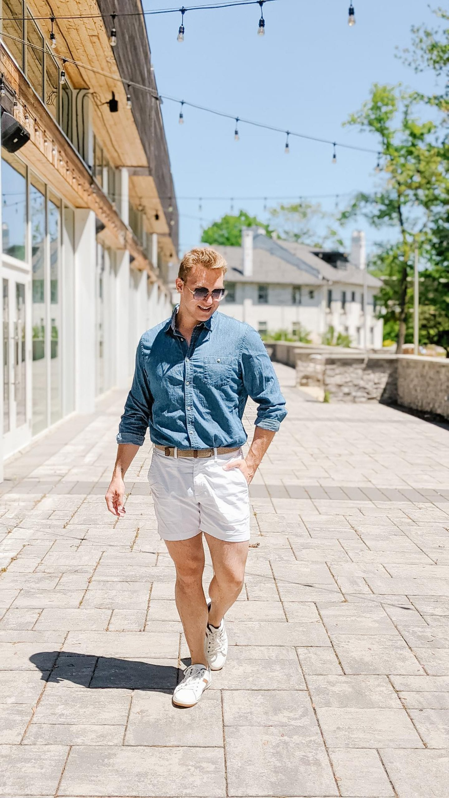 Christopher Allen's outside a white building wearing one of his Favourite Summer Fits.