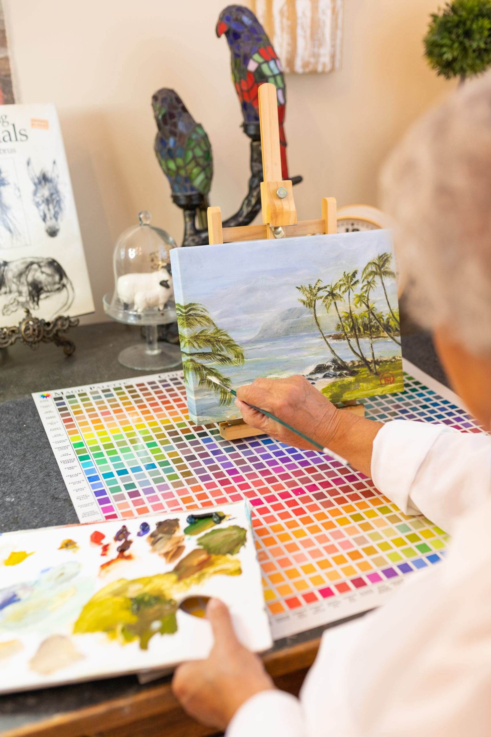 Peggy Harris getting back into painting by painting a tropical scene.