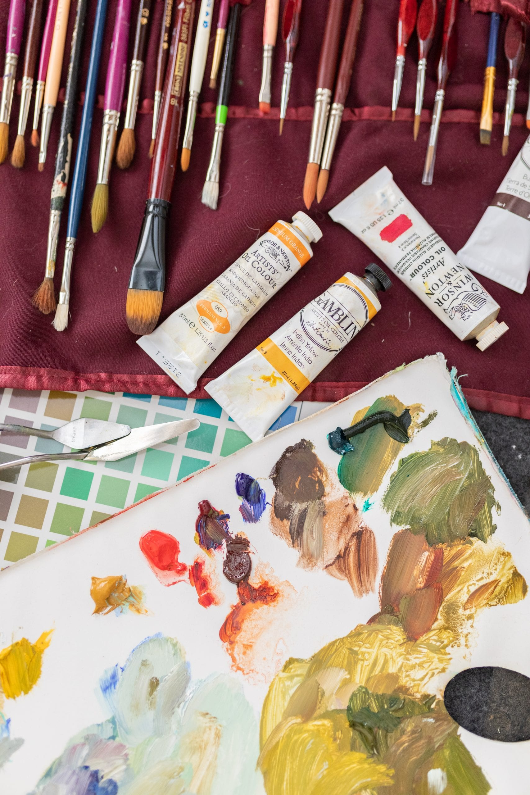 Peggy's paint brushes, mixing palette, and a few tubes of oil paint colours.