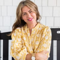 Jillian Harris in a yellow patterned shirt showing one of her Farm-Inspired Outfits