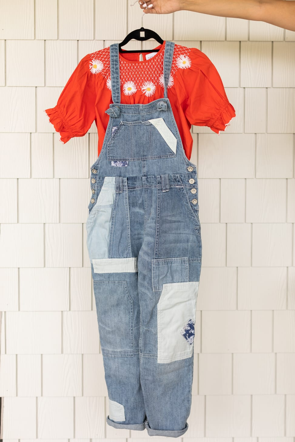 Jillian Harris' Favourite patchwork Overalls shown with a red short-sleeved prairie style shirt, one of her farm-inspired outfits.
