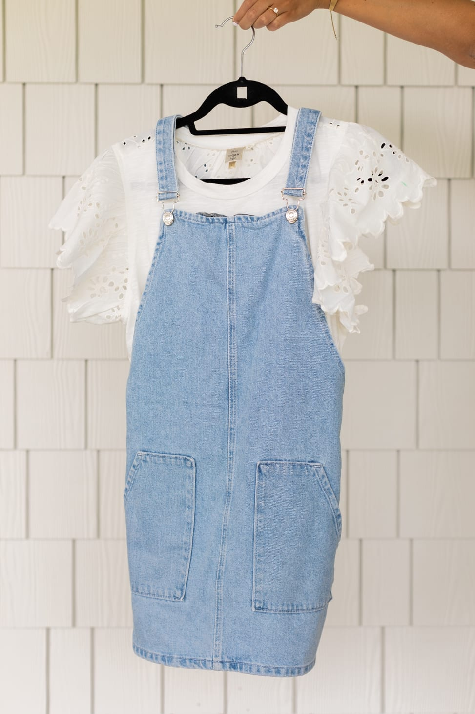 Knee length Overall Dress with a white t-shirt with floral pattern cut out on ruffled sleeves.