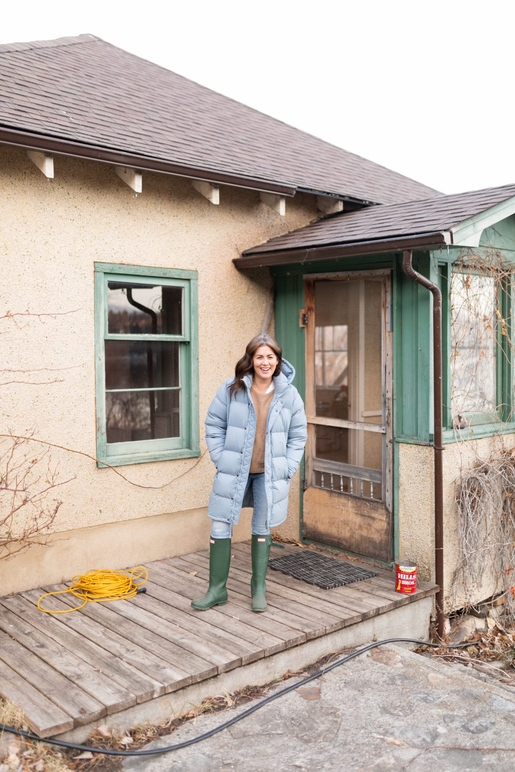 Jillian Harris on the front porch of her farmhouse before the refresh.