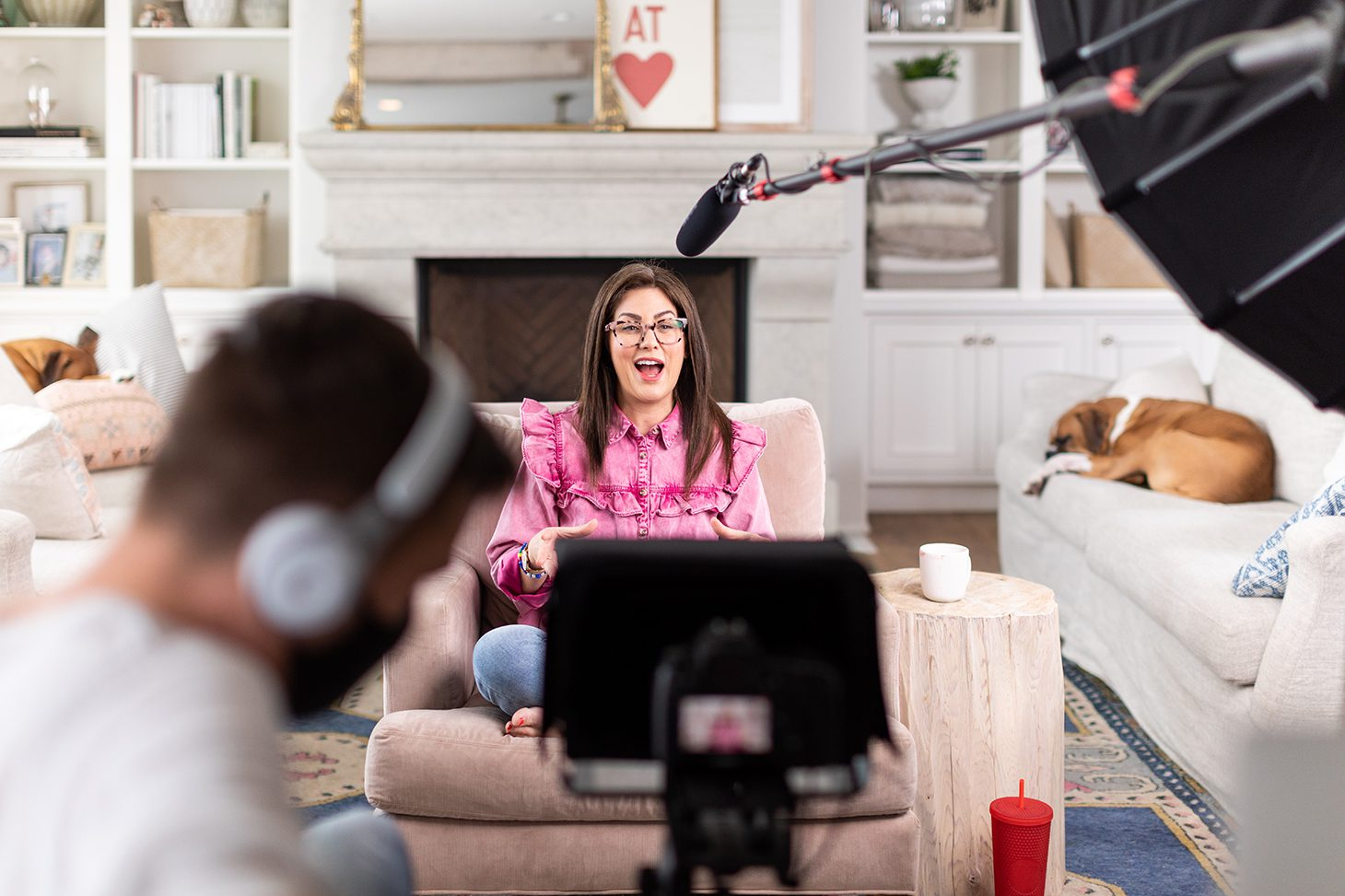 Jillian Harris filming for The Jilly Academy in her living room. Courses set to relaunch for fall semester.