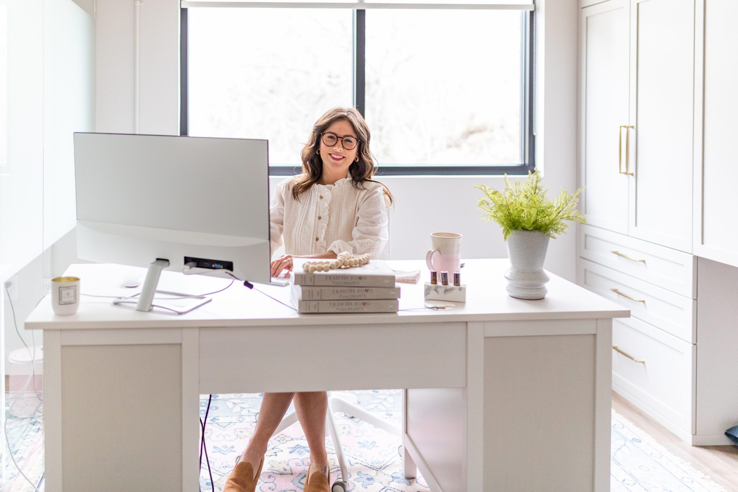 Jillian Harris sitting at her desk ready for the Fall Semester at The Jilly Academy.