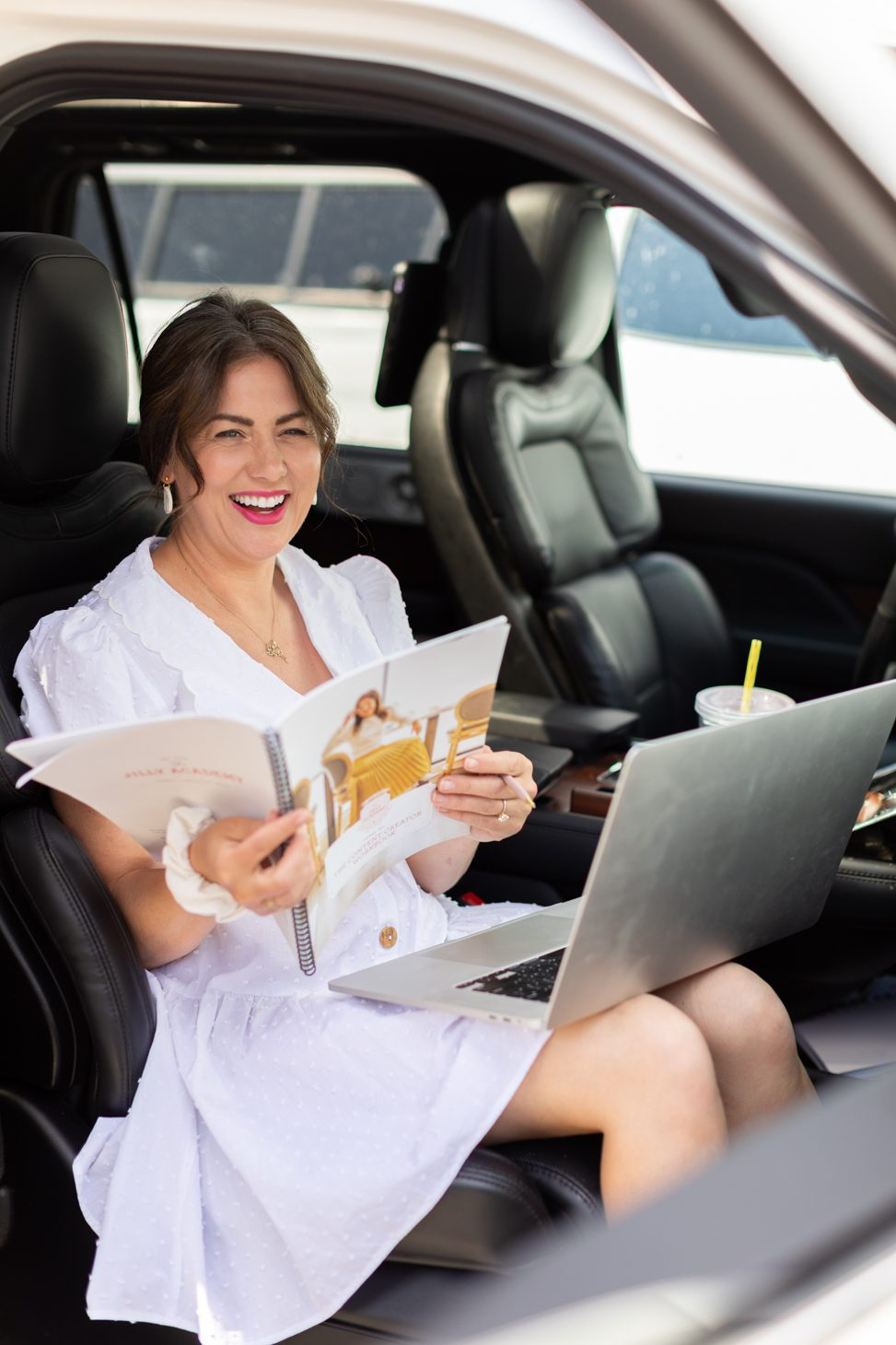 Jillian Harris checking in on The Jilly Academy Alumni during the summer, on-the-go in her car wearing a white dress.
